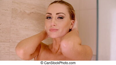 Bare Woman Taking a Shower with Hands on Head - Close up...