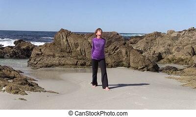 Beach Yoga Practice - a woman practicing yoga on the beach