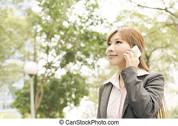 business woman use cellphone - Asian young business woman...