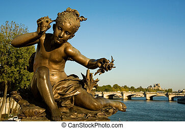 Closeup of a statue on the Pont Alexandre III, Paris, France...