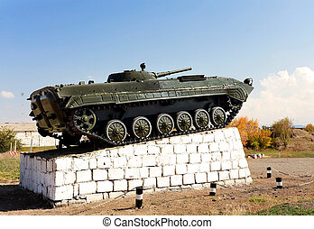 Infantry combat vehicle on a pedestal on a background of...