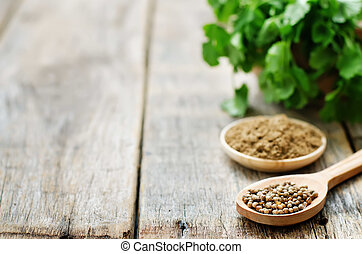 coriander on a dark wood background tinting selective focus...