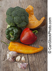Different vegetables on wooden surface
