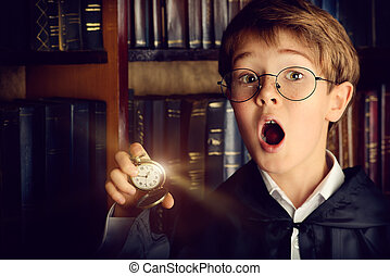 time goes by - Surprised boy stands with watch in the...