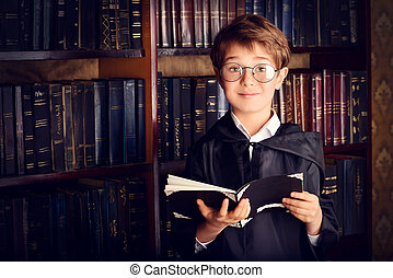 fabulous library - Smart boy stands in the library by the...