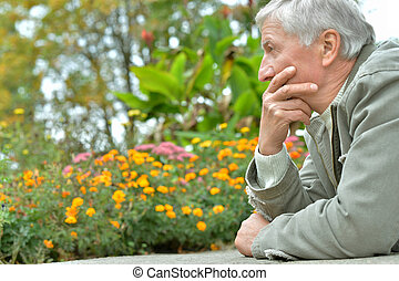 thoughtful elderly man - Portrait of thoughtful elderly man...