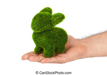 Rabbit made of grass in hand