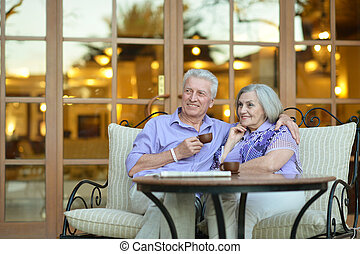 couple drinking coffee - Senior couple drinking coffee...