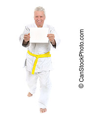 Karate Senior man with white poster on white background