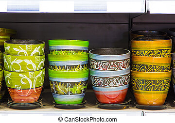Flowerpots - New colored flowerpots in a shelf in a market