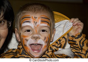Fancy dress. - Young boy in a tiger costume. Photo taken on:...