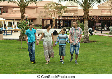 family in tropical ressort - Portrait of a happy family in...