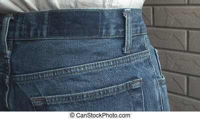 Wallet, - Man with his wallet in hip pocket, to illustrate...