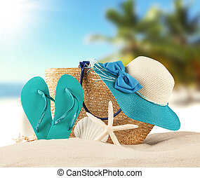 Summer beach with blue sandals and shells - Summer concept...