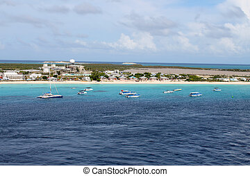 Bahamas beach - Catamarans and tour boats along the shore of...
