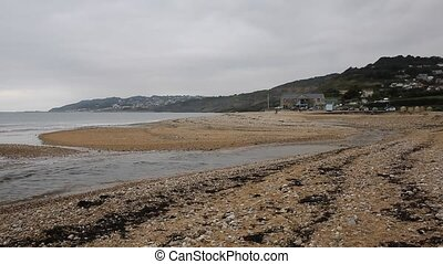 Charmouth beach Dorset England UK with pebbles and shingle...
