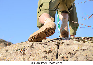Brown Shoes of a Boy Scout Climbing a Rock - Close up Brown...