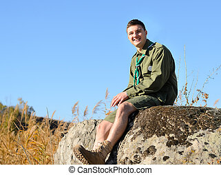 Smiling Handsome Boy Scout Sitting on the Rock - Handsome...