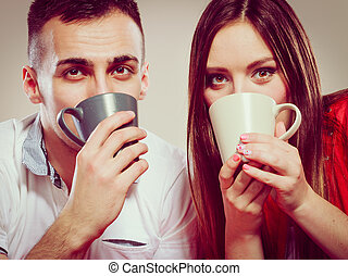 young funny couple drinking tea or coffee - Happiiness and...