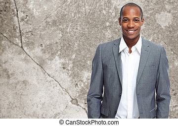 Man - Young executive businessman over office background
