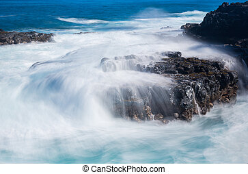 Raging sea flows over lave rocks on shore line - Strong sea...