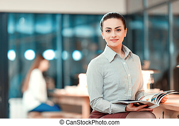 Beautiful young woman having business lunch - Successful...