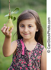 Girl taking a pear