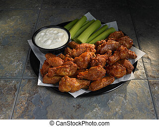 Buffalo Chicken Wings - Spicy chicken wings with celery and...