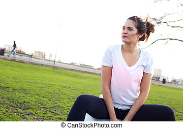 woman with a gym ball in the park