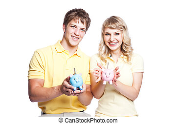 Young couple saving money - A young couple holding piggy...