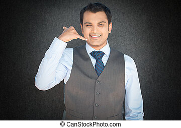 Man gesturing call me - Closeup portrait young confident man...
