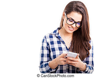 Sending text on a smartphone - Attractive hipster girl...