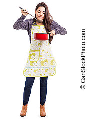 Dinner is ready - Beautiful young brunette wearing an apron...