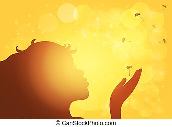 Silhouette of girl blowing dandelion in the rays of the sun....