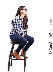 Young woman sitting on a chair