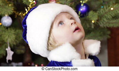 Child Snow Maiden - Girl in Christmas clothes near Christmas...