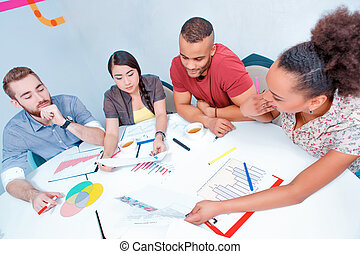 Young creative people at brainstorming - Creative...