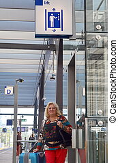 mature woman at a train station