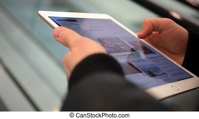 Businessmans hands using digital tablet in the shopping mall. Close up.  HD. 1920x1080