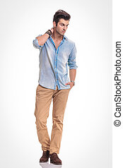 Attractive fashion man walking on studio background