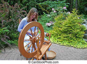 Woman Spinning Wool - This pretty woman is hand spinning...