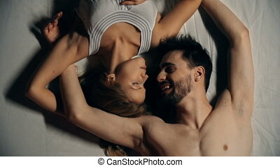 French Kiss - Above view of sweet lovers lying jack in bed...