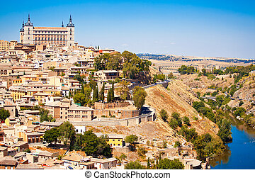 Toledo - Beautiful view to Alkazar and river Tajo in Toledo,...
