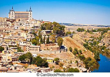Toledo - Beautiful view to Alkazar and river Tajo in Toledo,...