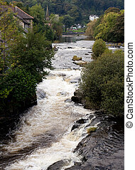 River runs rapidly through Llangollen in Wales - Rapids on...