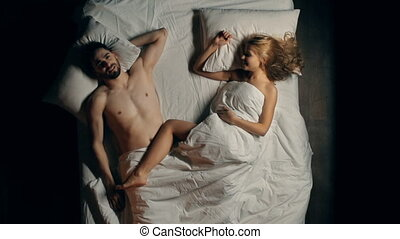 Intimate Connection - Happy lovers lying breathless in bed...