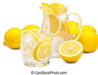 fresh lemons - fresh pieces of lemon in pitcher of water and...