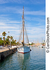 white yacht at the mooring in the port of Barcelona