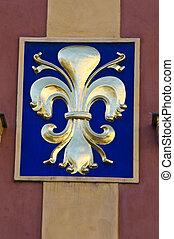 Fleur de lis - golden fleur de lis on a facade