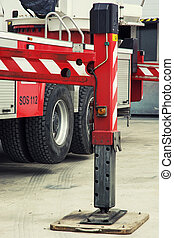 Stabilizing legs extended - Fire truck outrigger stabilizing...